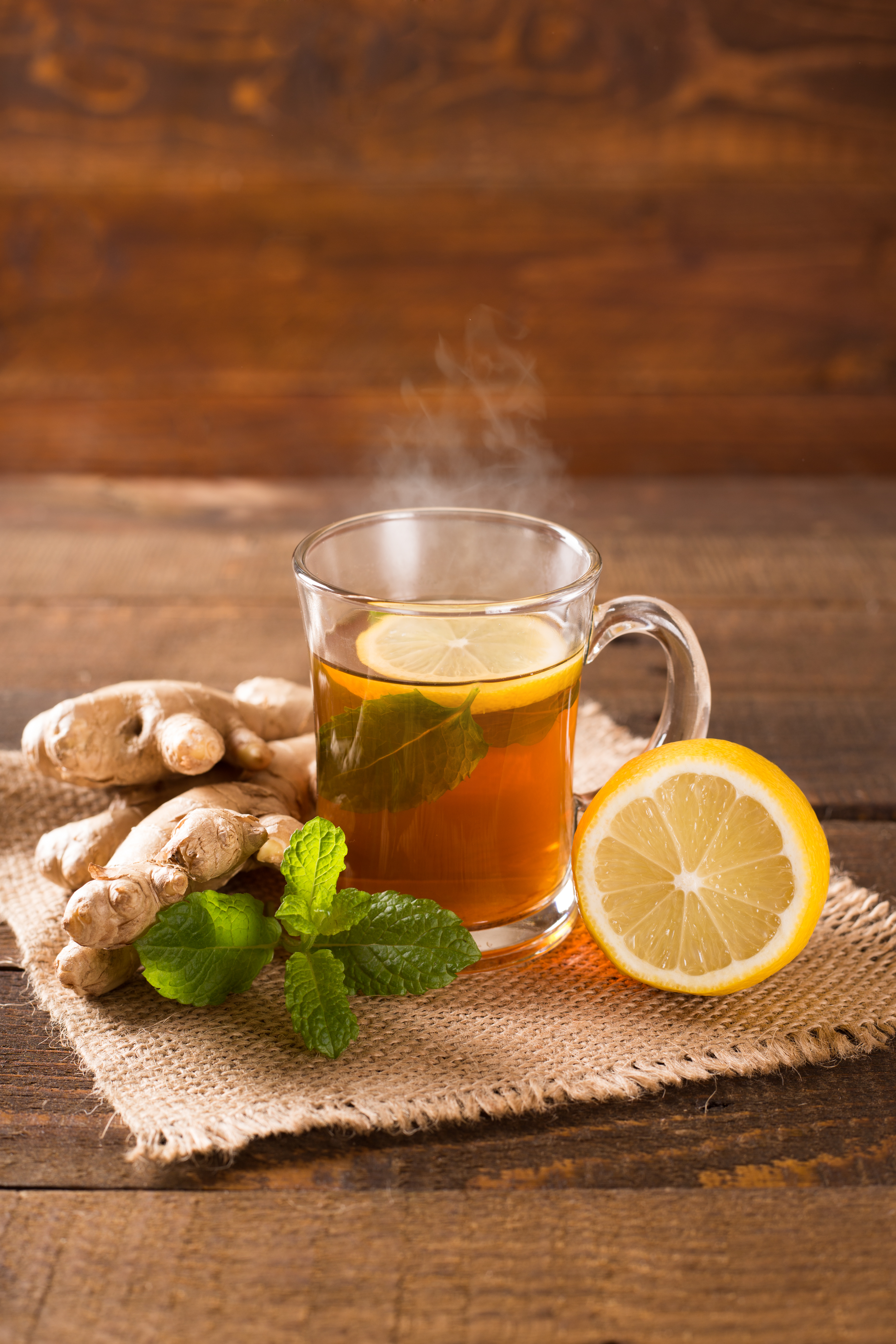 Homemade weight loss cup of hot ginger tea with mint and lemon